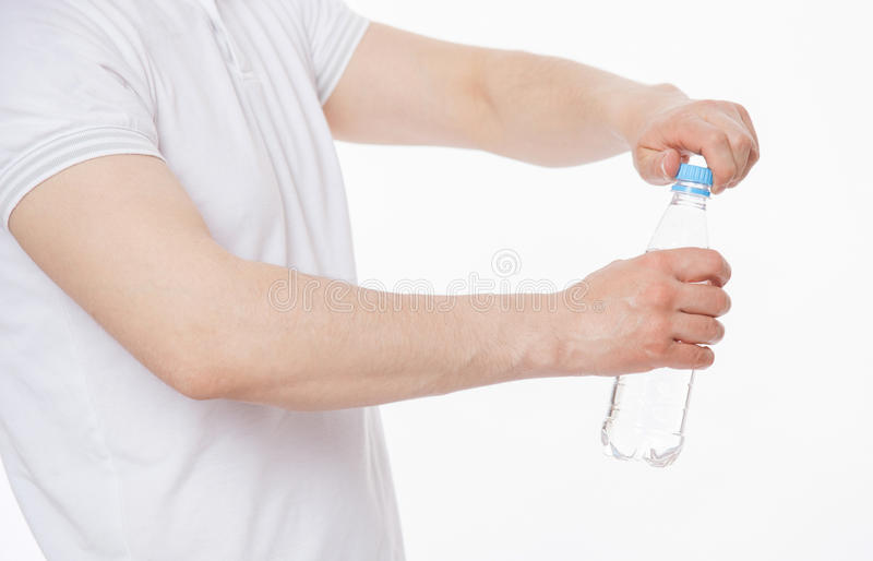 Young man holding a bottle of water. White background stock photo