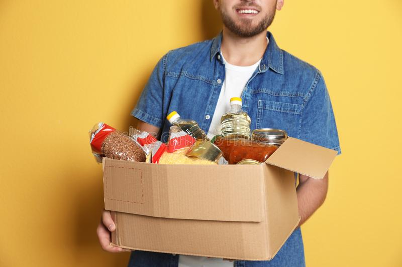 Young man holding box with donations royalty free stock photography