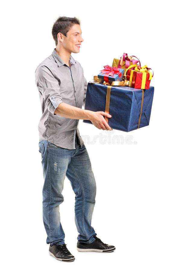 Young man holding a bunch of presents stock image