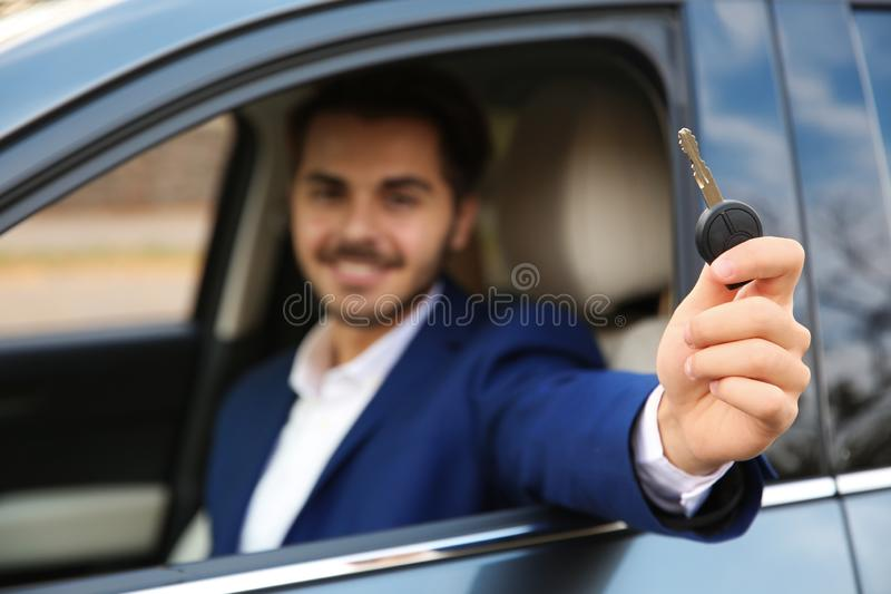 Young man holding car key in auto. Driving test. Young man holding car key in auto. Driving license test stock photos