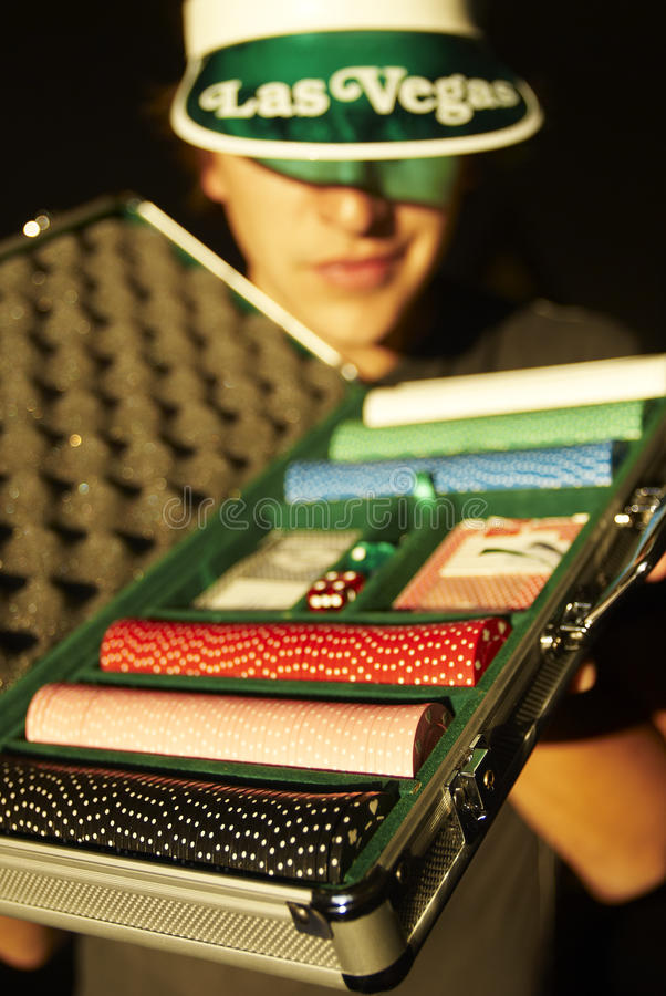 Free Young Man Holding Case With Poker Chips Stock Image - 12582951