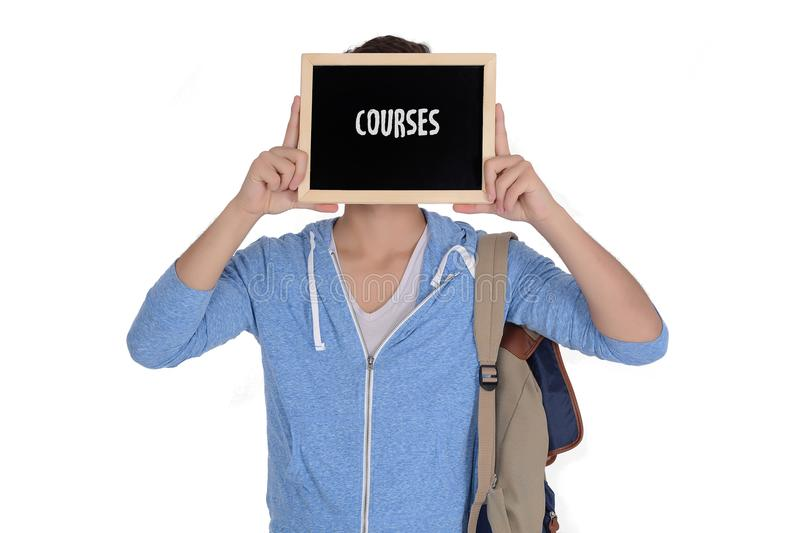 Young man holding chalkboard with courses text royalty free stock photography