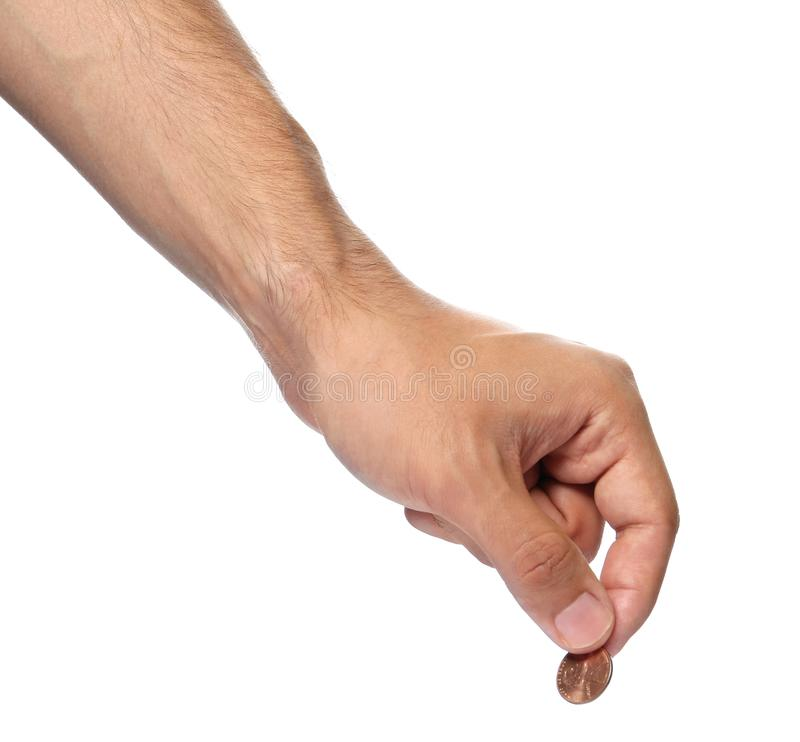 Young man holding coin on white background. Closeup view stock photo