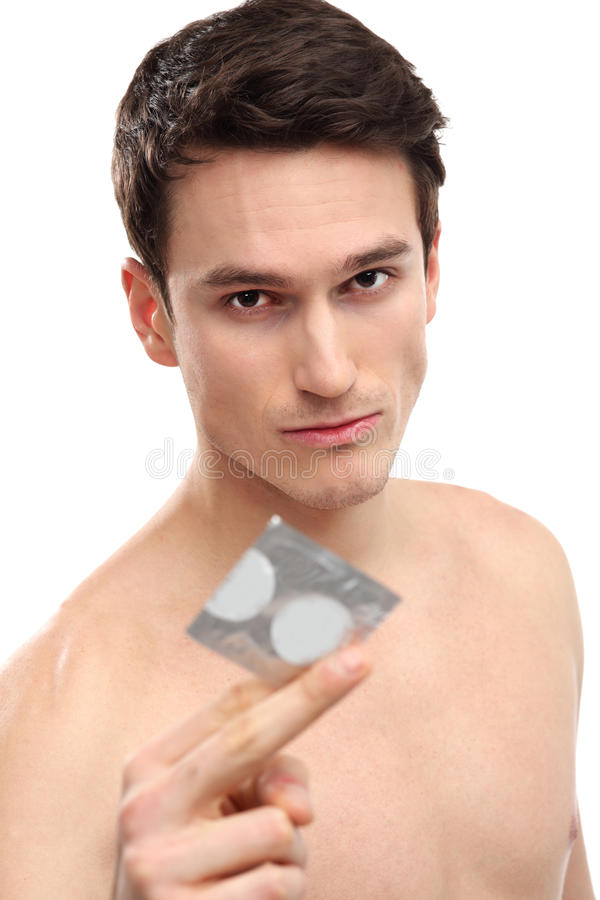 Download Young man holding condom stock photo. Image of serious - 29050048