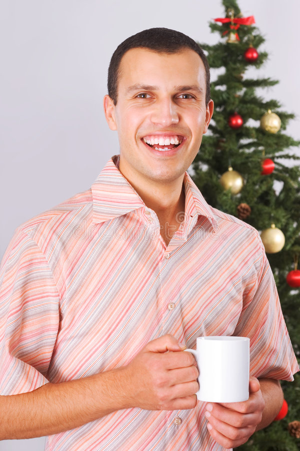 Young man holding cup with tea stock photos