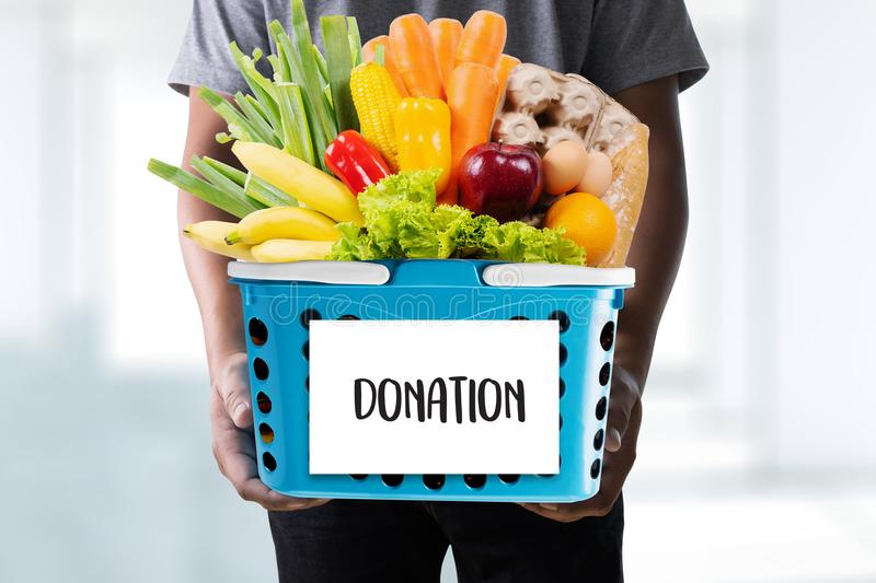 Young man holding Donation food donate Charity. Concept stock photos