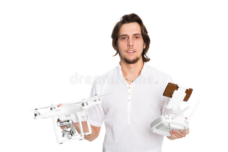 Young man holding a flying drone and remote control stock images