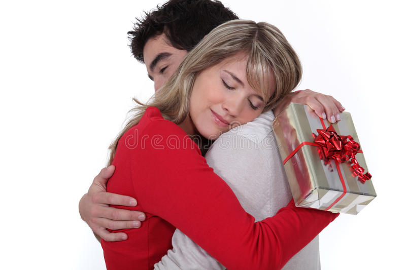 Young man holding girlfriend stock image