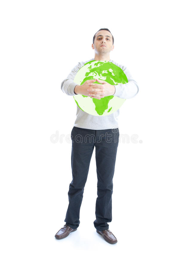 Young man holding green planet earth royalty free stock photography