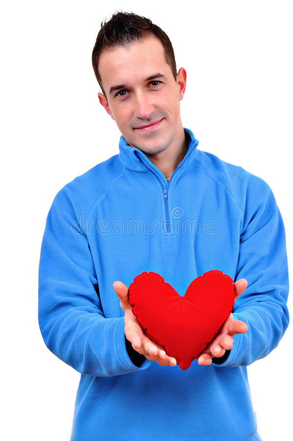 Young man holding heart stock photo
