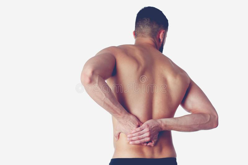 Young man holding his neck in pain. Medical concept.  stock photo