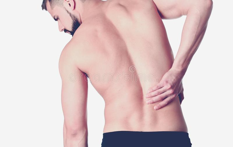 Young man holding his neck in pain. Medical concept.  stock image