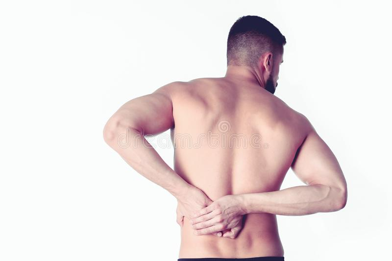 Young man holding his neck in pain. Medical concept.  royalty free stock photo