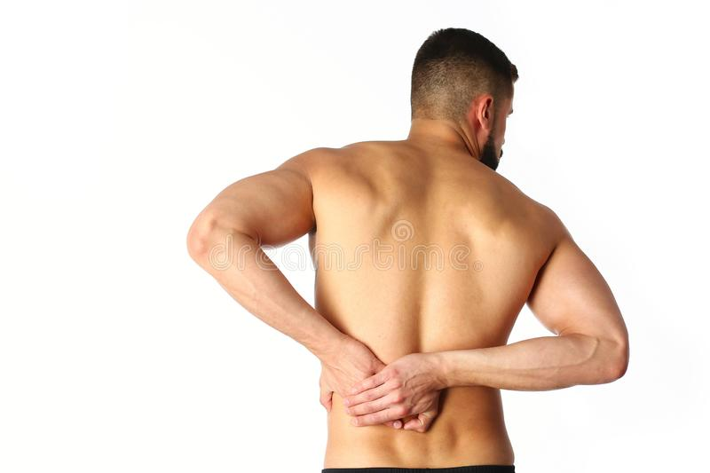 Young man holding his neck in pain. Medical concept.  stock images
