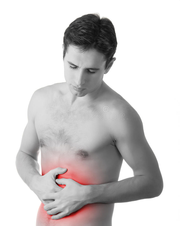 Young man holding his sick stomach in pain stock photos