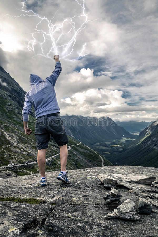 Young man is holding the lightning in hands stock images