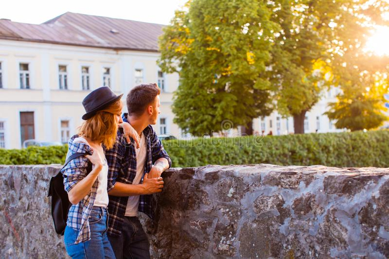 Young man holding lovely woman near the medieval castle royalty free stock images