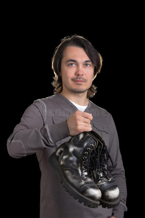 Free Young Man Holding Old Black Boots In His Hands Royalty Free Stock Photo - 25627655