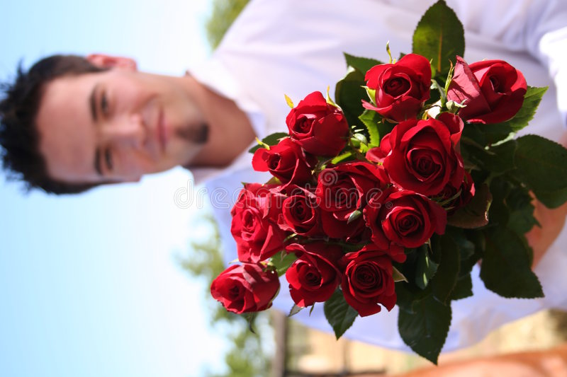 Young Man Holding out Roses