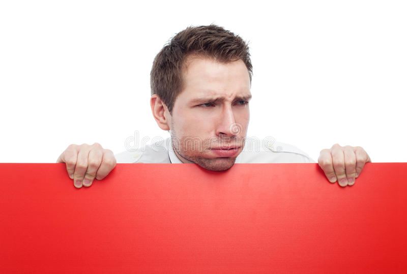 Download Young Man Holding Red Blank Sign Sneering Stock Image - Image: 12400137