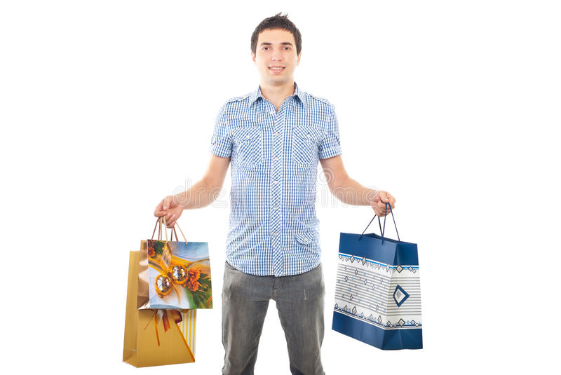 Young man holding shopping bags royalty free stock photo