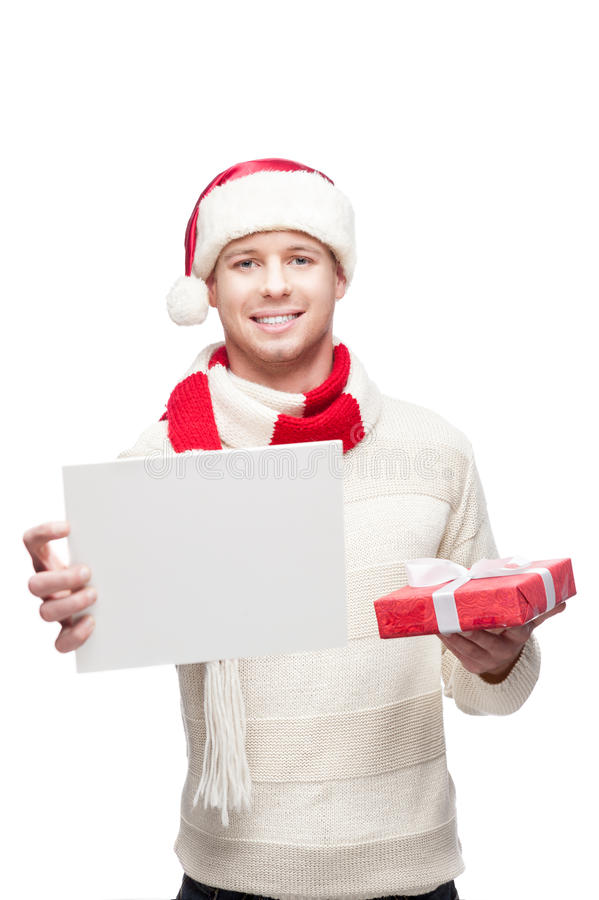 Download Young Man Holding Small Christmas Gift And Sign Stock Photo - Image: 27169940