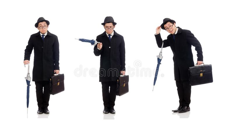 Young man holding suitcase and umbrella isolated on white royalty free stock images