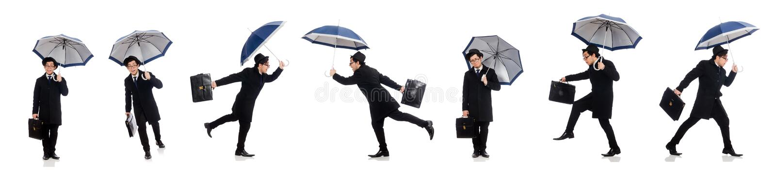 Young man holding suitcase and umbrella isolated on white royalty free stock image