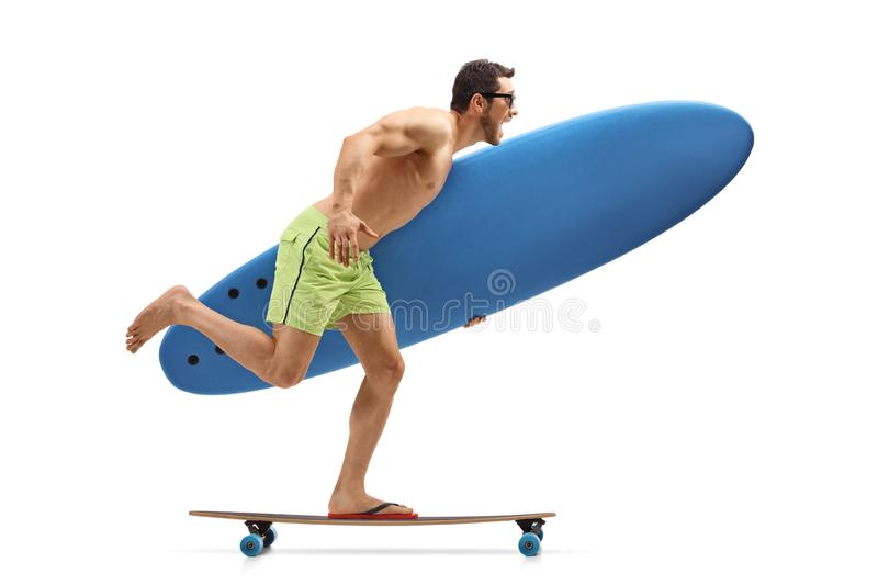 Young man holding a surfing board and riding a longboard. Isolated on white background royalty free stock image
