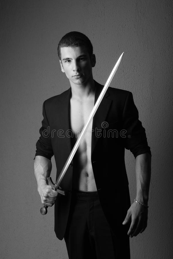 Young man holding sword