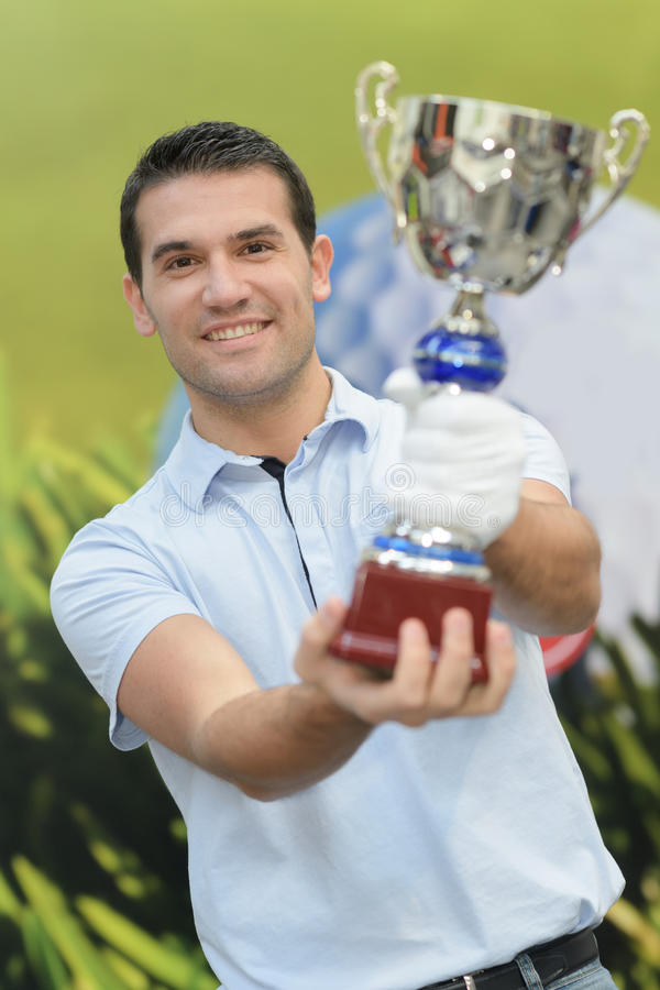Young man holding trophy stock photography