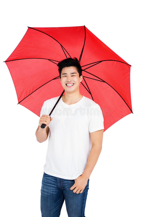 Young man holding a umbrella royalty free stock image