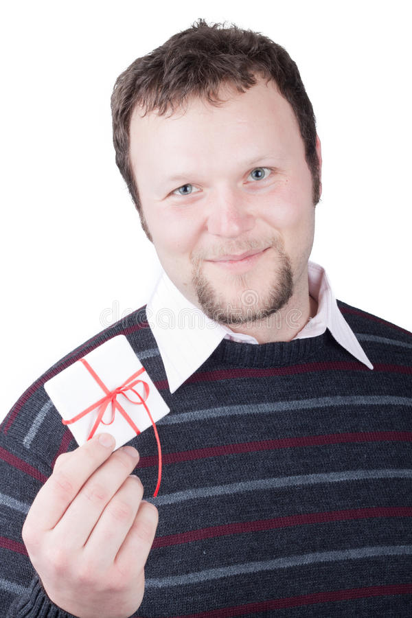 Young man holding valentine gift in his hand stock photo