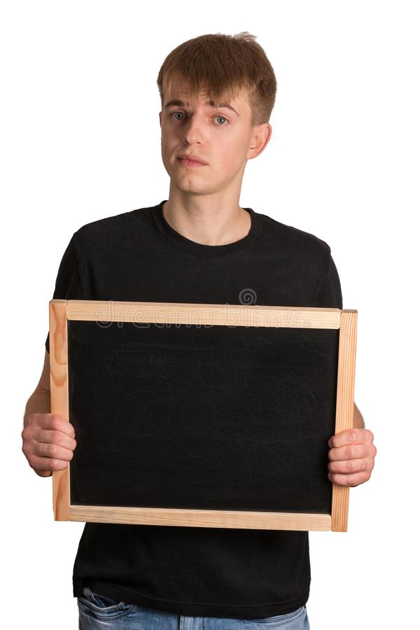 A young man holds a black board. On white background stock photo