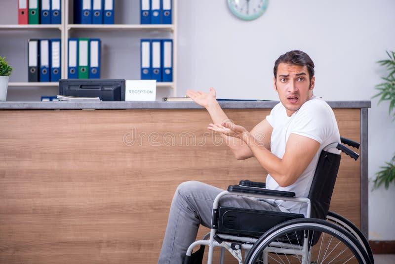 Young man at hospital reception desk royalty free stock photo