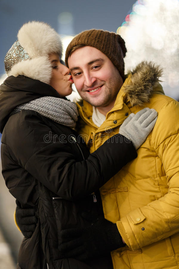 Young man hugging his girlfriend stock image