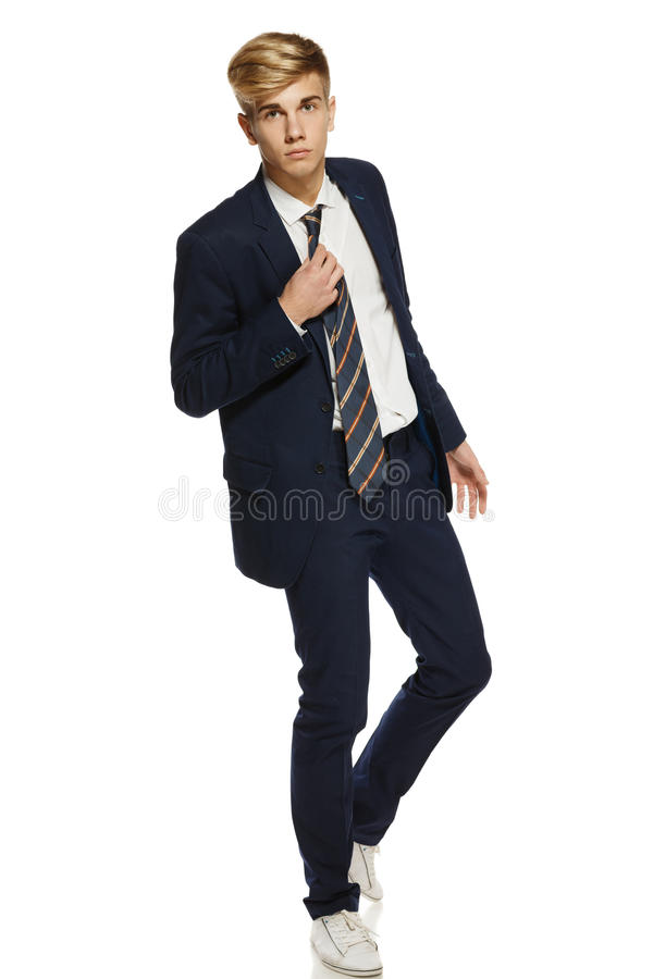 Free Young Man In Suit Walking Stock Photos - 27401943