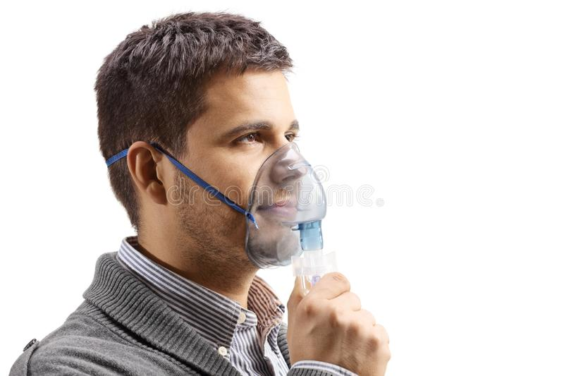 Young man with an inalation mask stock image