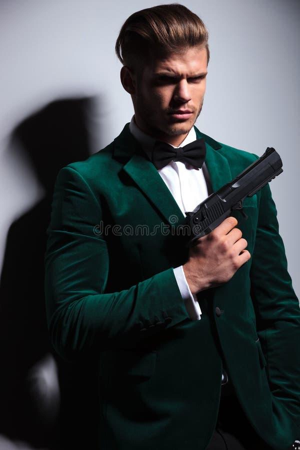 Young man James Bond asassin type stock photo