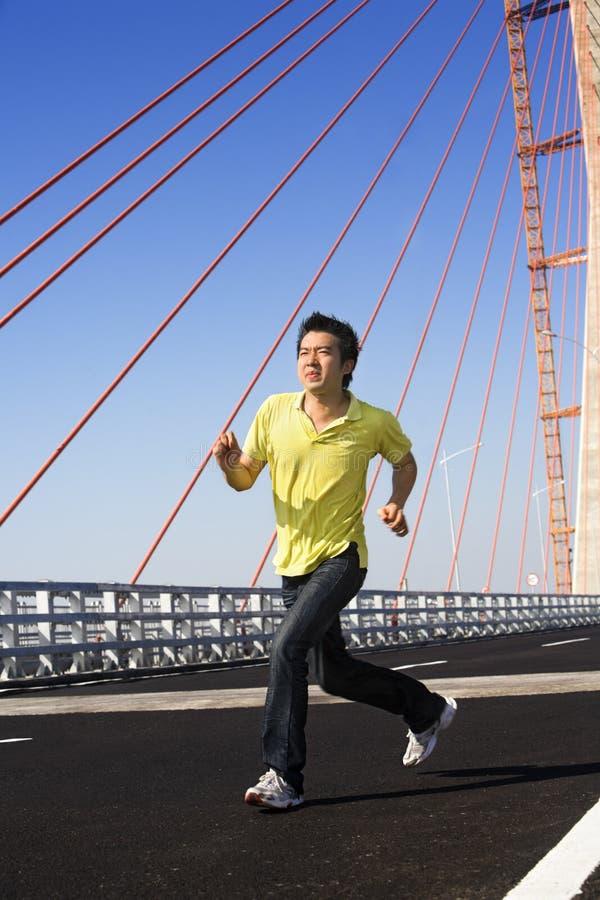 Young man jog in bridge area stock photo