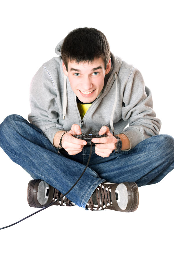 Young man with a joystick for game console stock image