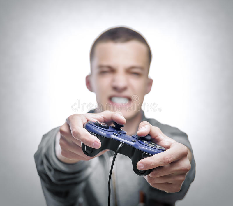 Young man with a joystick stock images