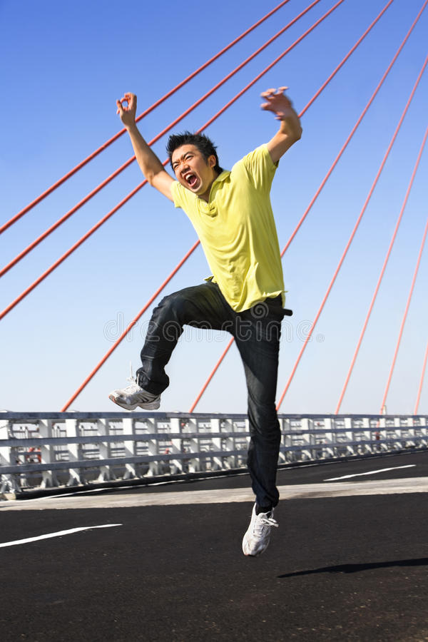 Young man jump with wierd expression