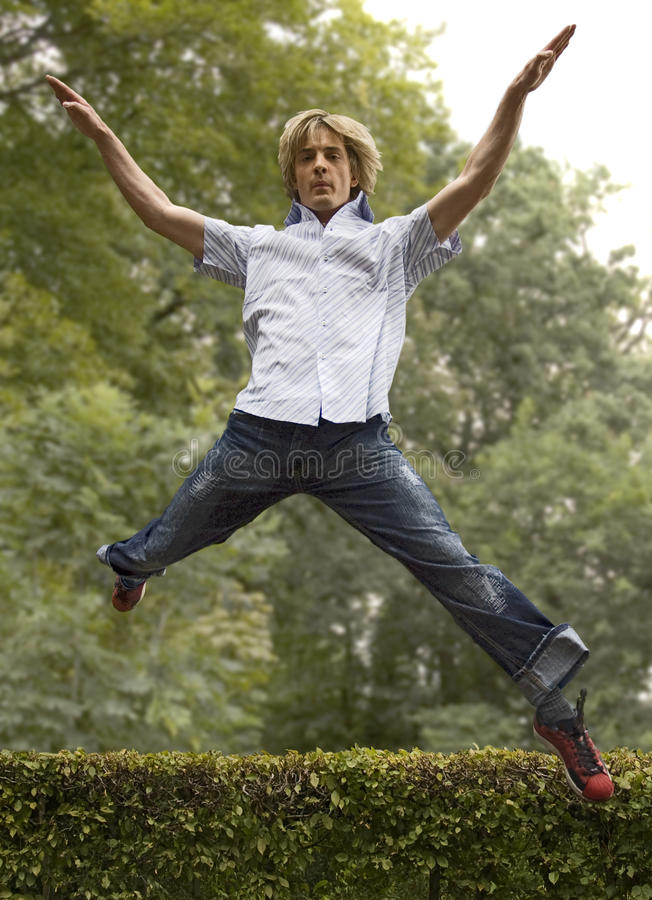 Download Young Man Jumping In Forest Royalty Free Stock Photo - Image: 11149585