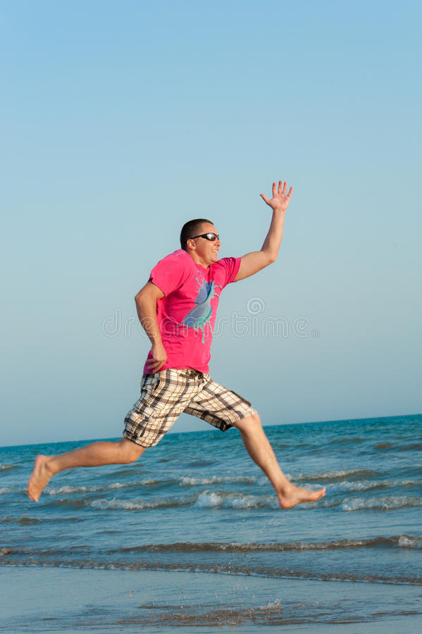 Download Young Man Jumping In The Ocean Stock Image - Image: 20874959
