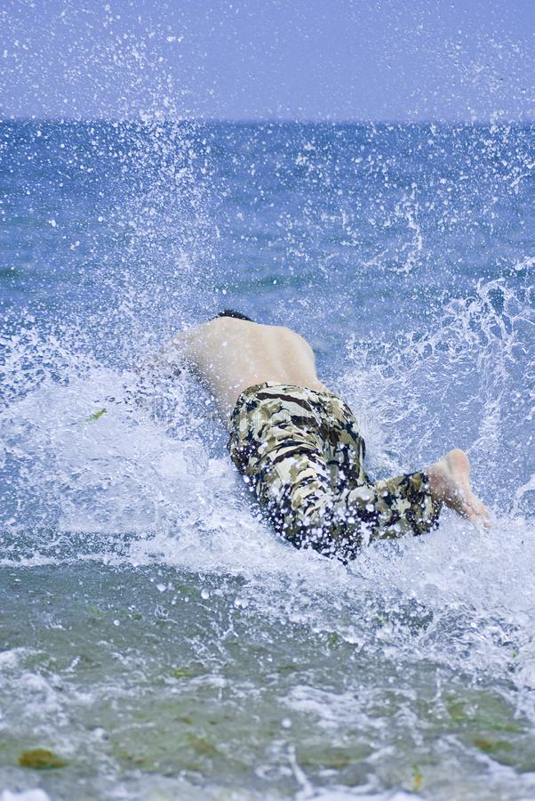 Download Young Man Jumping Into Sea Water Stock Image - Image: 2903303