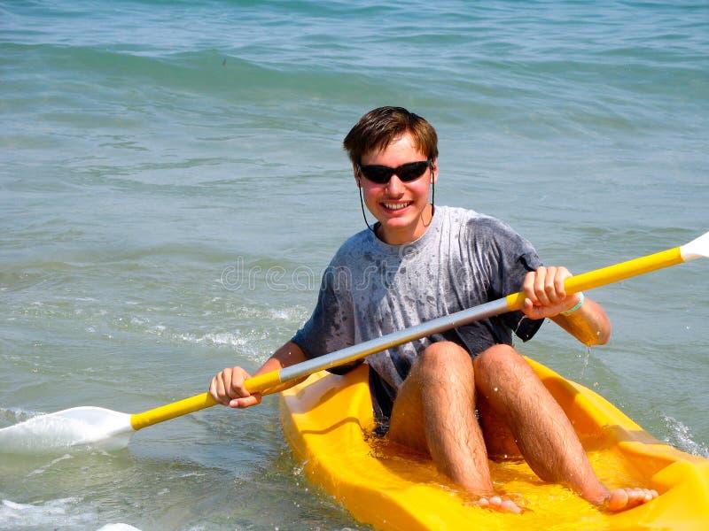 Young man kayaking stock photos