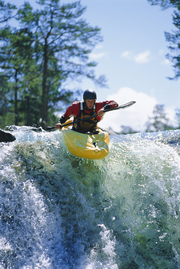 Free Young Man Kayaking On Waterfall Stock Photos - 6077563