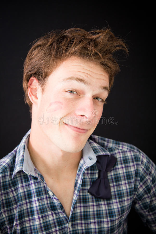 Download Young Man With Kiss Trace On The Cheek Stock Photo - Image: 29490328