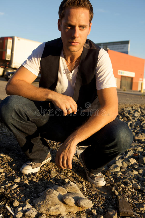 Download Young Man Kneeling stock photo. Image of male, graffiti - 10877198